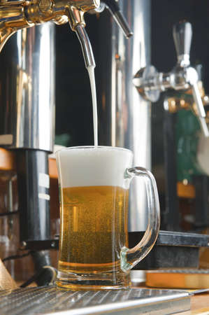 beer gets into in glass. glass of beer on the bar of bar