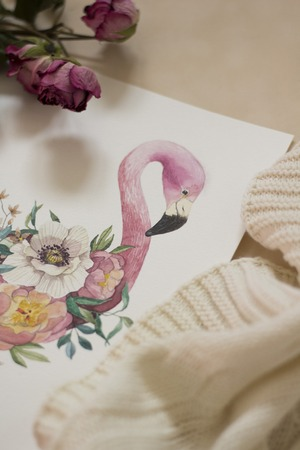 Workspace. Exotic flowers and flamingo painted with watercolor, paintbrush, isolated on white background. Overhead view. Flat lay, top view