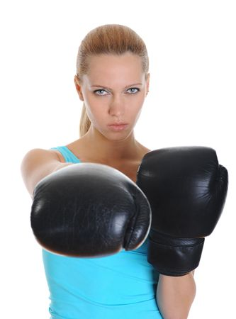combative: Beautiful sports girl with a look of decision in black boxing gloves.  Isolated on white background Stock Photo