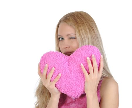 Beautiful girl with heart in hands winks. Isolated on white background Stock Photo - 6776961