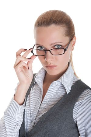 Portrait of the business girl looking from under glasses. Isolated on white background photo