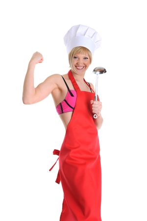 Strong young cook in a red apron with a ladle. Isolated on white background photo