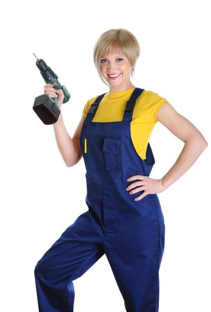 Beautiful girl with a drill in building overalls. Isolated on white background photo