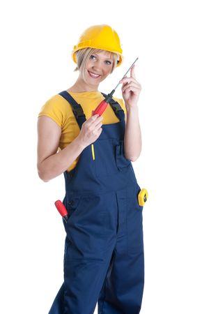 Beautiful girl with building overalls with a screw-driver. Isolated on white background photo