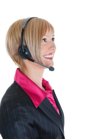 Beautiful woman-operator with headphone smiles. Isolated on white background Stock Photo - 6820424