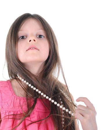 Portrait of a little girl wearing a necklace of pearls. Isolated on white background Stock Photo - 6820460