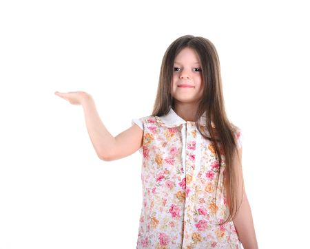 Little girl with long hair holds a hand upwards photo