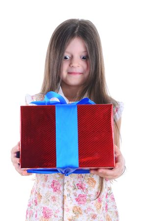Portrait of the girl surprised with a gift. Isolated on white background photo