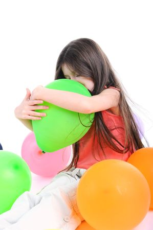 Girl embraces a green balloon. Isolated on white background photo