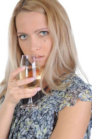 The blue-eyed girl with a champagne glass in a hand. Isolated on white background photo
