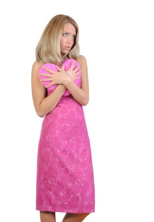 Sad girl in a pink dress with a heart in his hands. Isolated on white background photo