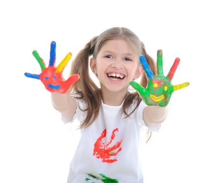 Fine smiling girl with the palms painted by a paint. Isolated on  white background photo