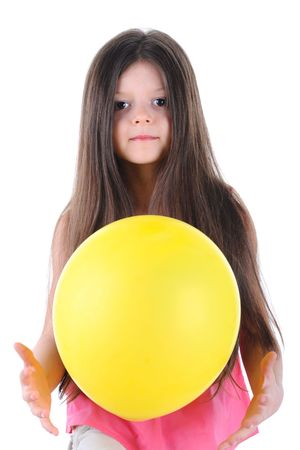 The little girl holding a yellow balloon in the hands. Isolated on white background photo