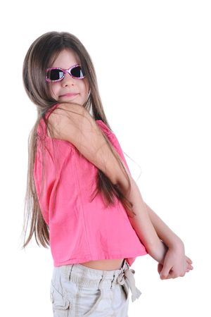 The little girl in sunglasses poses.  Isolated on white background photo