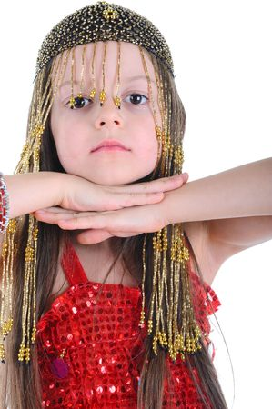 Little girl in a beaded hat clasped her hands under her chin. Isolated on white background photo