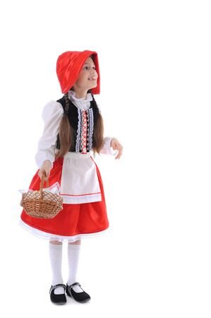 Girl in a red cap with a basket in her hand. Isolated on white background photo