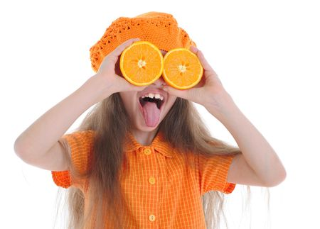 Funny girl with oranges shows language. Isolated on white background Stock Photo - 6820565