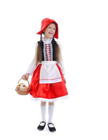 Little girl in a red cap and apron. Isolated on white background photo