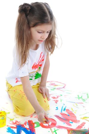 Little girl with long hair draws colored paint on the floor Stock Photo - 6820569