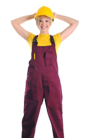 Smiling girl in the construction overalls and helmet. Isolated on white background photo
