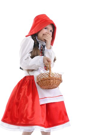 Girl in a red cap was frightened. Isolated on white background photo