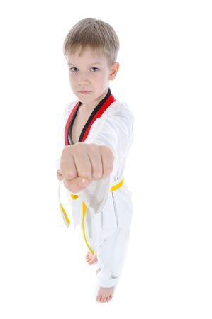 Young athlete demonstrates his fist. Isolated on white background photo