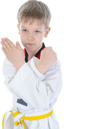 Boy in a kimono has crossed hands in a protective pose. isolated on a white background  photo