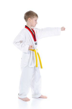 Boy in a kimono punched. Isolated on white background photo