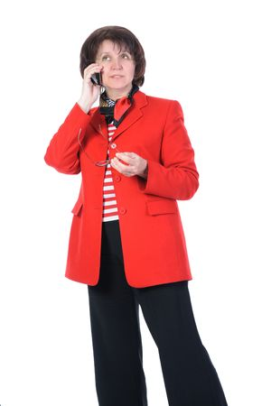 Adult business woman with a phone in a red jacket. Isolated on white background photo