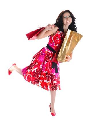 Joyful beautiful long-haired girl with shopping. Isolated on white background Stock Photo - 6883084