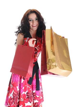 Joyful brunette beautiful girl with bags. Isolated on white background photo