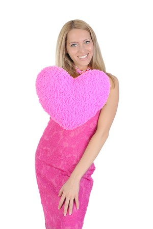 Funny girl in a pink dress holding heart on his outstretched hand. Isolated on white background Stock Photo - 6883074