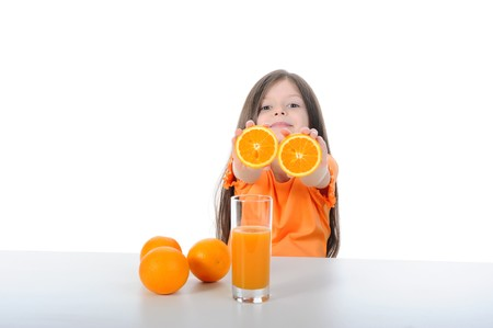 Girl shows orange segments. Isolated on white background photo