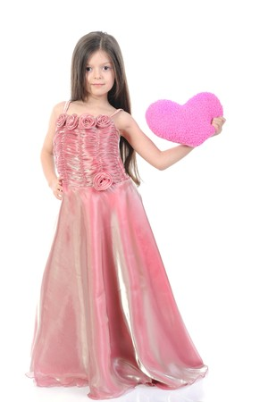 little girl in evening dress with a heart. Isolated on white background photo