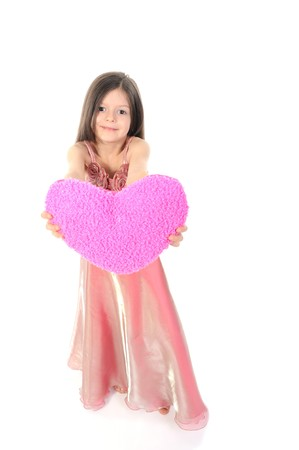 little girl in evening dress stretches the heart. Isolated on white background photo