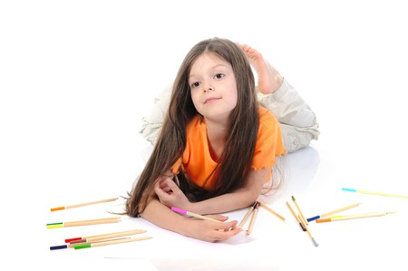 Little beautiful girl draws pencils. Isolated on white background photo