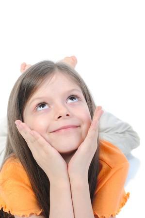 Prodigy: Dziewczynka piÄ™kne marzenia leżącego na podÅ'odze. Samodzielnie na biaÅ'ym tle  Zdjęcie Seryjne