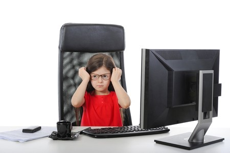 little girl wears glasses at the table in front of a computer. Isolated on white background Stock Photo - 6883175