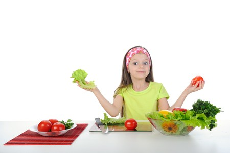 little girl with fresh vegetables. Isolated on white background photo