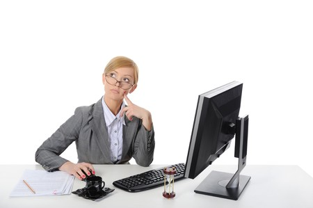 Young beautiful businesswoman on the computer. Isolated on white background. Stock Photo - 6883167