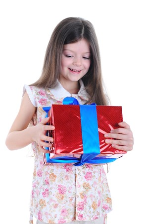Happy little girl cuddled the red box with a blue ribbon. Isolated on white background photo