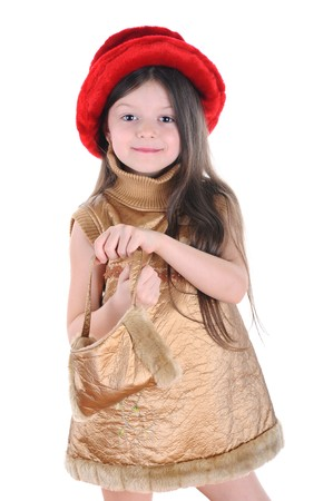 little girl in a red hat and gold dress keep in hands a purse.  Isolated on white background photo