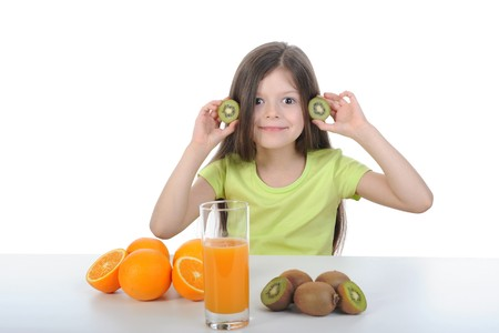 little girl holding slices of kiwi fruit in their hands. Isolated on white background photo
