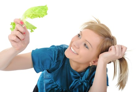 Beautiful girl with lettuce in her hand. Isolated on white background photo