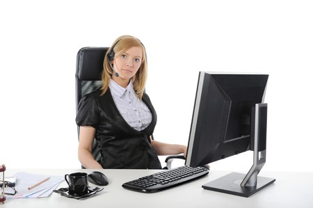Beautiful girl operator of the computer in the office. Isolated on white background Stock Photo - 6964363