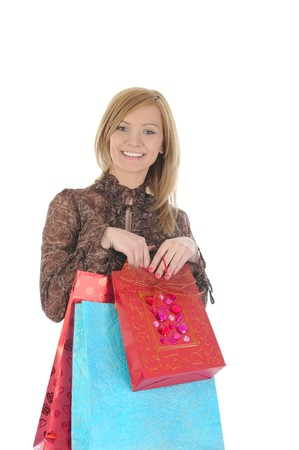 Beautiful girl with shopping bags looking into the camera. Isolated on white background photo
