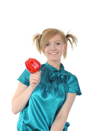 Young smiling girl holding a red pepper. Isolated on white background photo