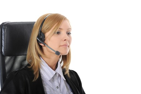 Young office worker with headset. Isolated on white background  photo