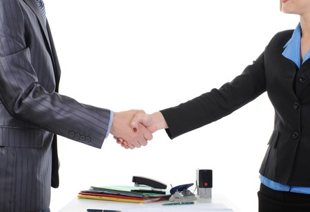 Handshake of business partners, when signing documents. Isolated on white background Stock Photo - 6970561
