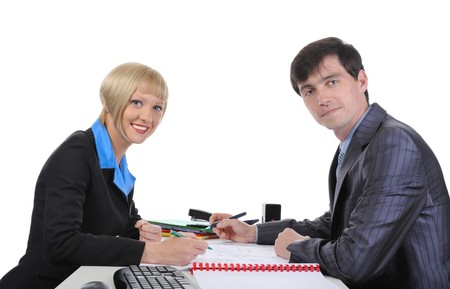 Business man and woman when signing documents. Isolated on white photo